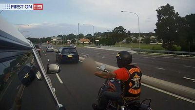A bikie recognises a mobile speed van travelling through Newcastle and makes an obscene gesture. (9NEWS)