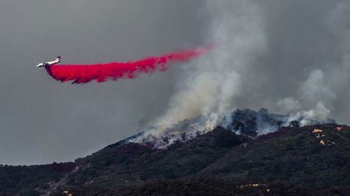 n total, 14,000 firefighters were battling blazes across California, which is seeing earlier, longer and more destructive wildfire seasons