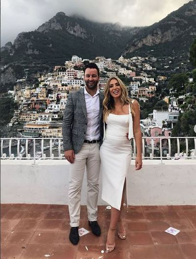 Nadia Bartel in Rebecca Vallance, with husband, Jimmy Bartel, in Italy, June 2018