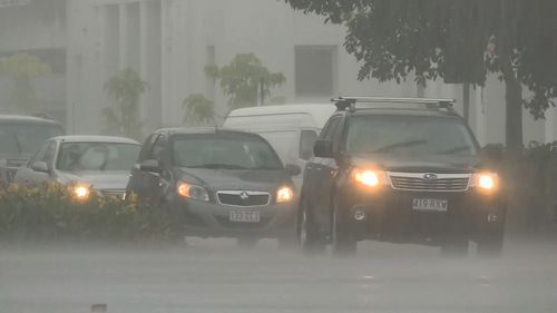 Queensland flash flooding: highways cut and residents stranded among torrential rain