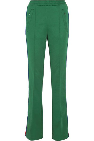 "<a href=""https://www.net-a-porter.com/au/en/product/803164/gucci/striped-satin-jersey-track-pants"" target=""_blank"" draggable=""false"">Gucci striped satin-jersey track pants</a>, $800"