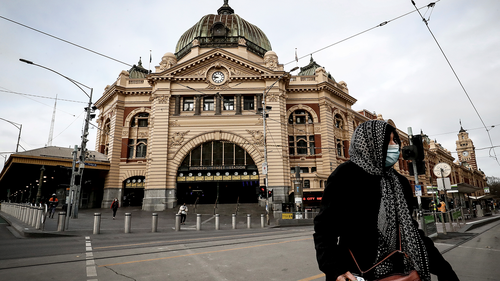 A woman is seen wearing a face mask out Flinders Street Station on July 23, 2020 in Melbourne, Australia.