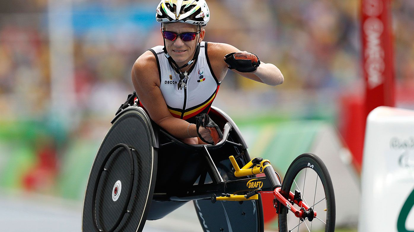In this Sept. 10, 2016, file photo, Belgium's Marieke Vervoort warms up for the athletics women's 400-meter T52 final, during the Rio 2016 Paralympic Games