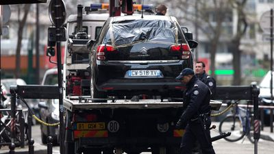 Police have removed the car believed to have been used in the shooting at the Charlie Hebdo headquarters where 12 people were killed. (AAP)