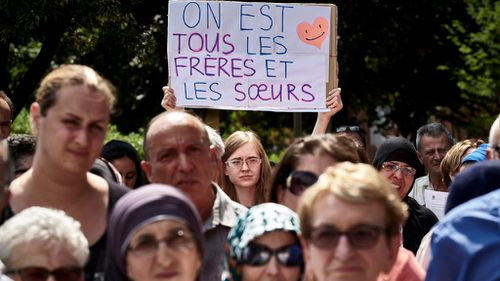 Christians and Muslims alike mourn murdered French priest