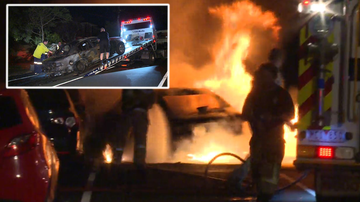 Man refuses to leave smashed car until it bursts into flames.