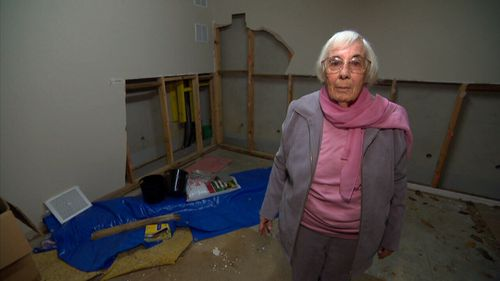 Maurine Moore had to deal with a leak in her unit after a pipe burst.