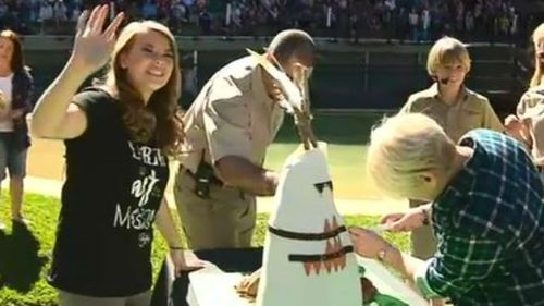 Bindi waves to fans in the 'Crocoseum'. (9NEWS)