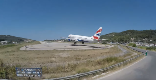 The runway at Skiathos Airport has a sign warning people to keep away from the aircraft blast, but it doesn't stop thrill-seekers looking for the ultimate selfie.