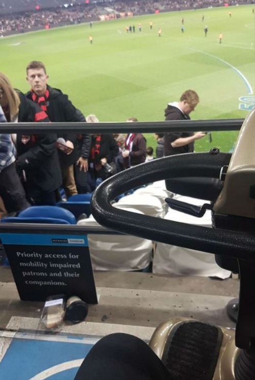 Reddit user bluejeans90210 posted an image on a mobility scooter at an AFL match. (Reddit)