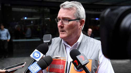 NSW Ambulance Inspector Michael Corlis speaks to the media outside 44 Market Street where emergency services cleared a possibly suspicious substance found at the Argentinian Consulate.