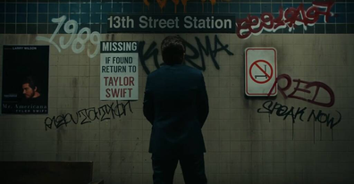 Taylor Swift's album names are graffitied on the wall.