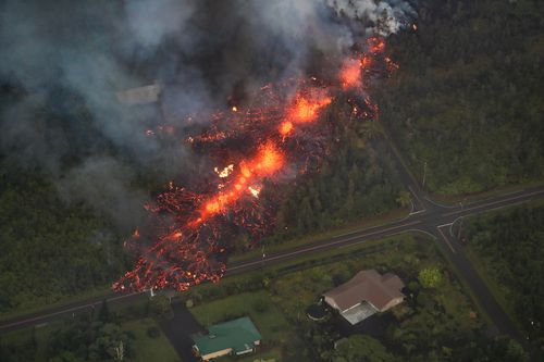 A 2000-foot long fissure erupts within the Leilani Estates subdivision. (AAP)