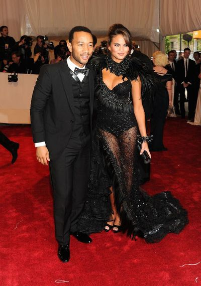 John Legend and Chrissy Teigen in Chris March attend the Alexander McQueen: Savage Beauty Costume Institute Gala at The Metropolitan Museum of Art in 2011