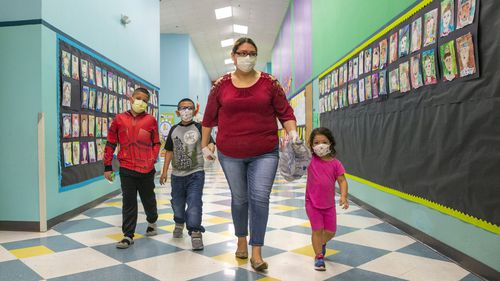 Children in the United States wear masks while at school.