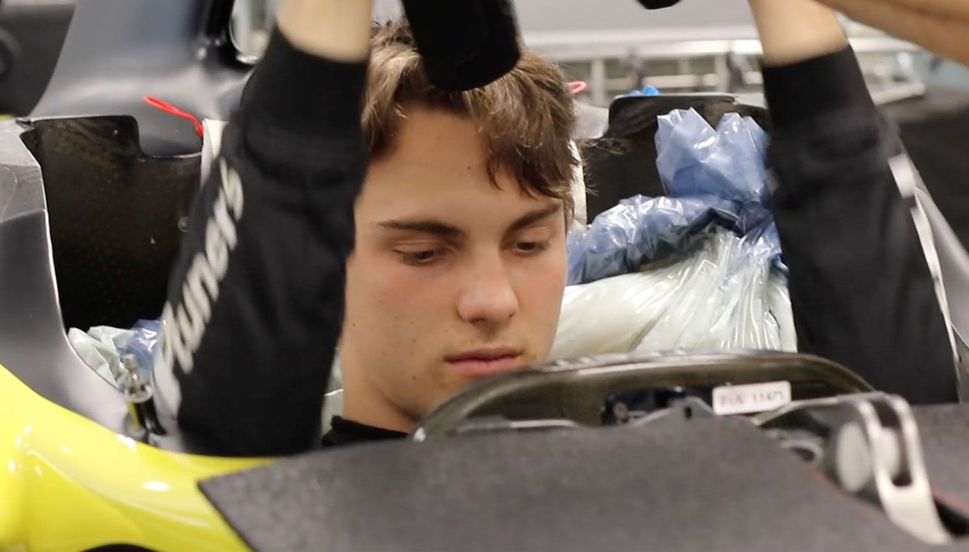 Oscar Piastri during his seat fitting at Renault's Enstone factory.