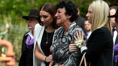 Hughes' mother Virginia is supported by her daughter Megan, pictured left. (AAP)