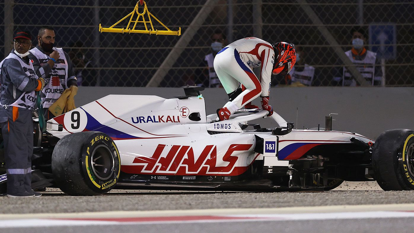 Nikita Mazepin climbs out of his wrecked Haas on the opening lap of the Bahrain Grand Prix.