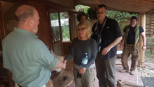 American tourist Kim Endicott (centre) following her rescue after being kidnapped by unknown gunmen in Uganda's Queen Elizabeth National Park.