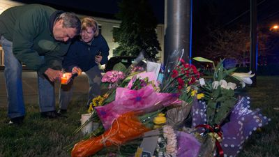 Washington, DC, residents place flowers and light candles outside the Belgium embassy. (AFP)