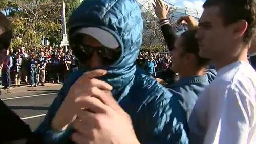 The minority of football fans covering their face cast a negative image on the majority who are well-behaved. (9NEWS)