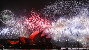 Fireworks explode over the Sydney Harbour Bridge and the Sydney Opera House in the midnight display during New Year's Eve celebrations on January 1, 2020 in Sydney, Australia