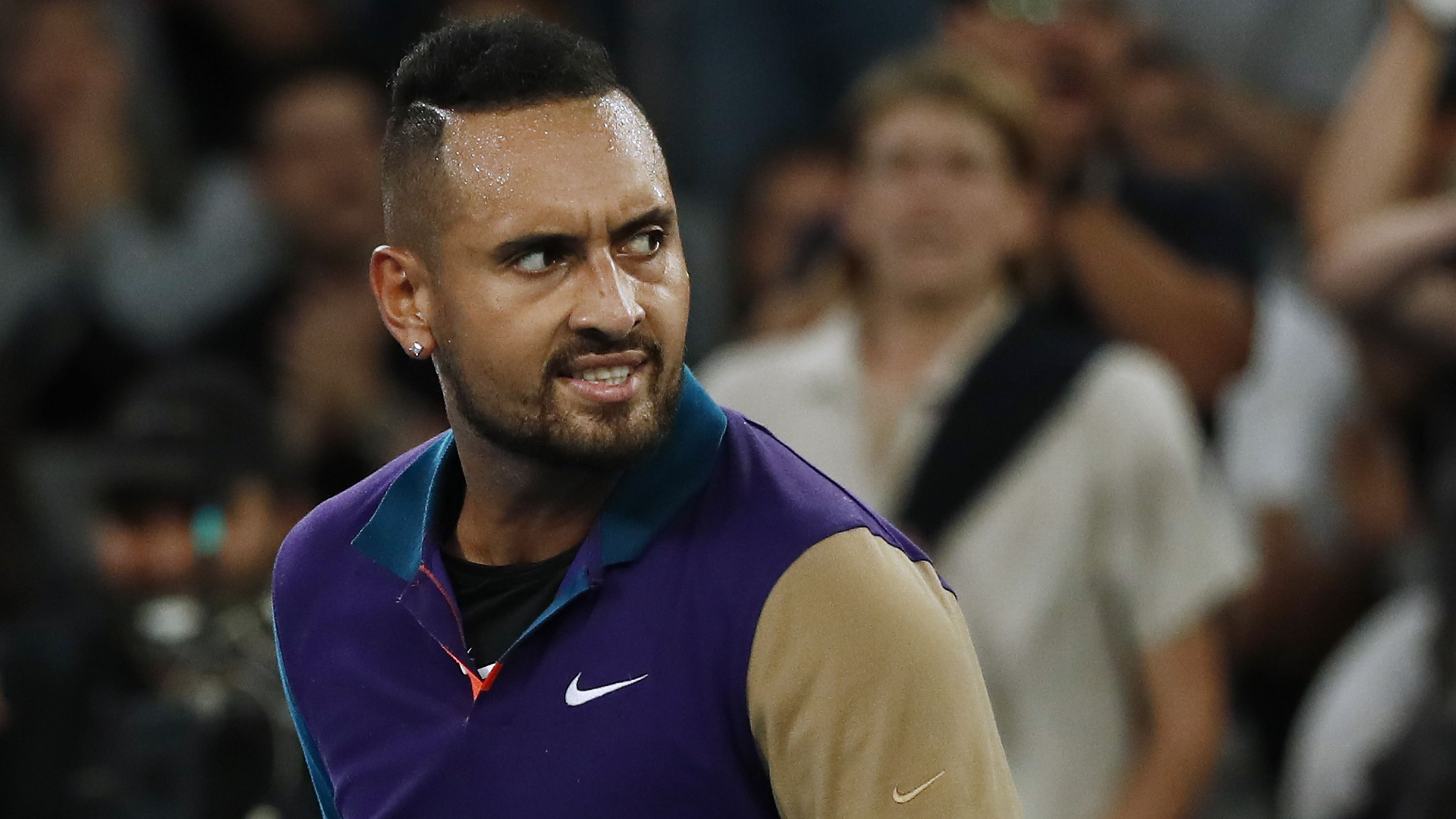 MELBOURNE, AUSTRALIA - FEBRUARY 12: Nick Kyrgios of Australia reacts in his Men's Singles third round match against Dominic Thiem of Austria during day five of the 2021 Australian Open at Melbourne Park on February 12, 2021 in Melbourne, Australia. (Photo by Daniel Pockett/Getty Images)