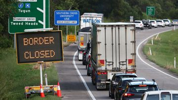 Traffic is seen on The Pacific Highway in New South Wales near the Queensland Border, Thursday, March 26, 2020.