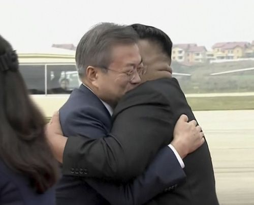 South Korean President Moon Jae-in, left, hugs North Korean leader Kim Jong-un upon arrival in Pyongyang, North Korea