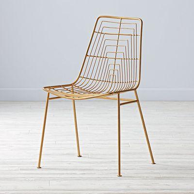 "<a href=""https://www.landofnod.com/gold-domino-desk-chair/s465361"" target=""_blank"">Domino Desk Chair, $227.91.</a>"