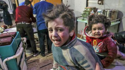 More than 130 killed in assault on Syrian suburb
