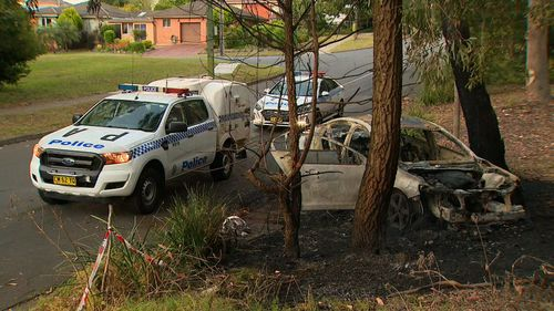 Police are investigating whether a burnt out car fouond nearby is linked to the shooting.