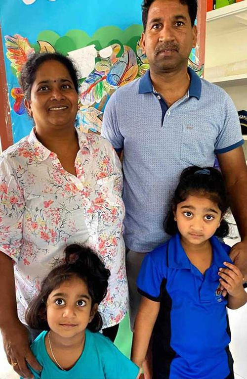 The family on Tharnicaa's first day at kindergarten on Christmas Island.