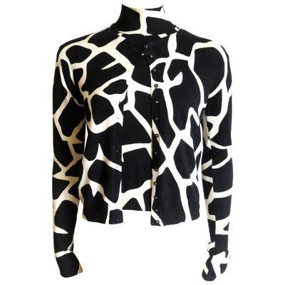 "<a href=""https://www.1stdibs.com/fashion/clothing/sweaters/1990s-john-galliano-paris-giraffe-print-silk-sweater-twinset/id-v_1387993"" target=""_blank"">Vintage '90s twin set, $653, John Galliano at 1stdibs</a>"