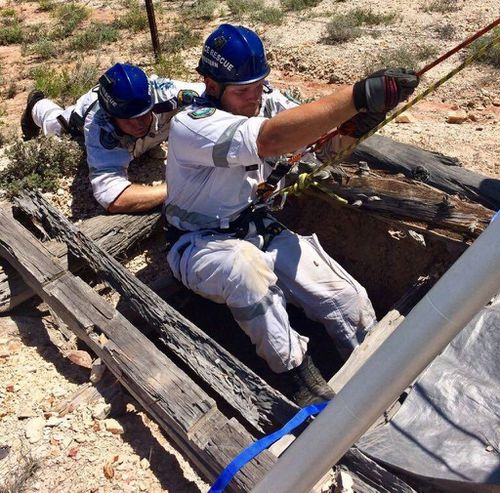 Police rescuers used a pulley and harness to bring the woman back to the surface. (Supplied)