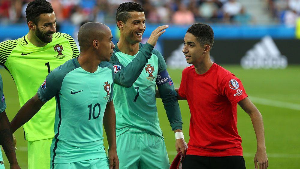 Ball boy crashes Portugal team photo before Euro win