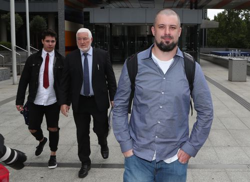 Neil Erikson (right) leaves the Federal Court in Melbourne yesterday. (AAP)