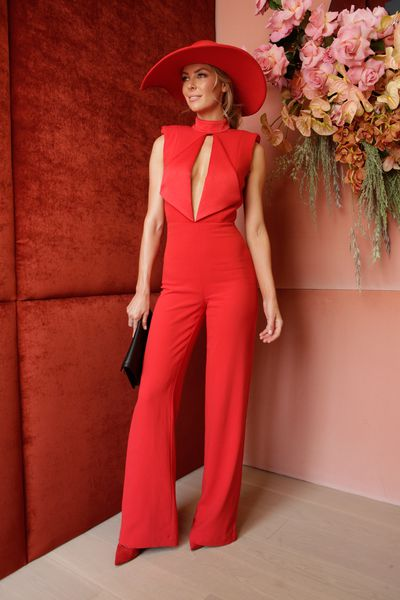 """<p>3) Wear the pants</p> <p>Jennifer Hawkins at Melbourne Cup Day in a Misha Collection jumpsuit and Melissa Jackson hat<br style=""""box-sizing: border-box;""""> </p>"""