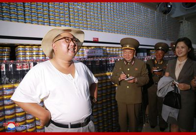 &nbsp;In another image, snapped by official photographers, Kim stood proudly with his hands on his hips in front of rows and rows of stockpiled food products.<br /> <br /> This is a stark contrast to widespread food shortages which has reportedly gripped the secretive country.