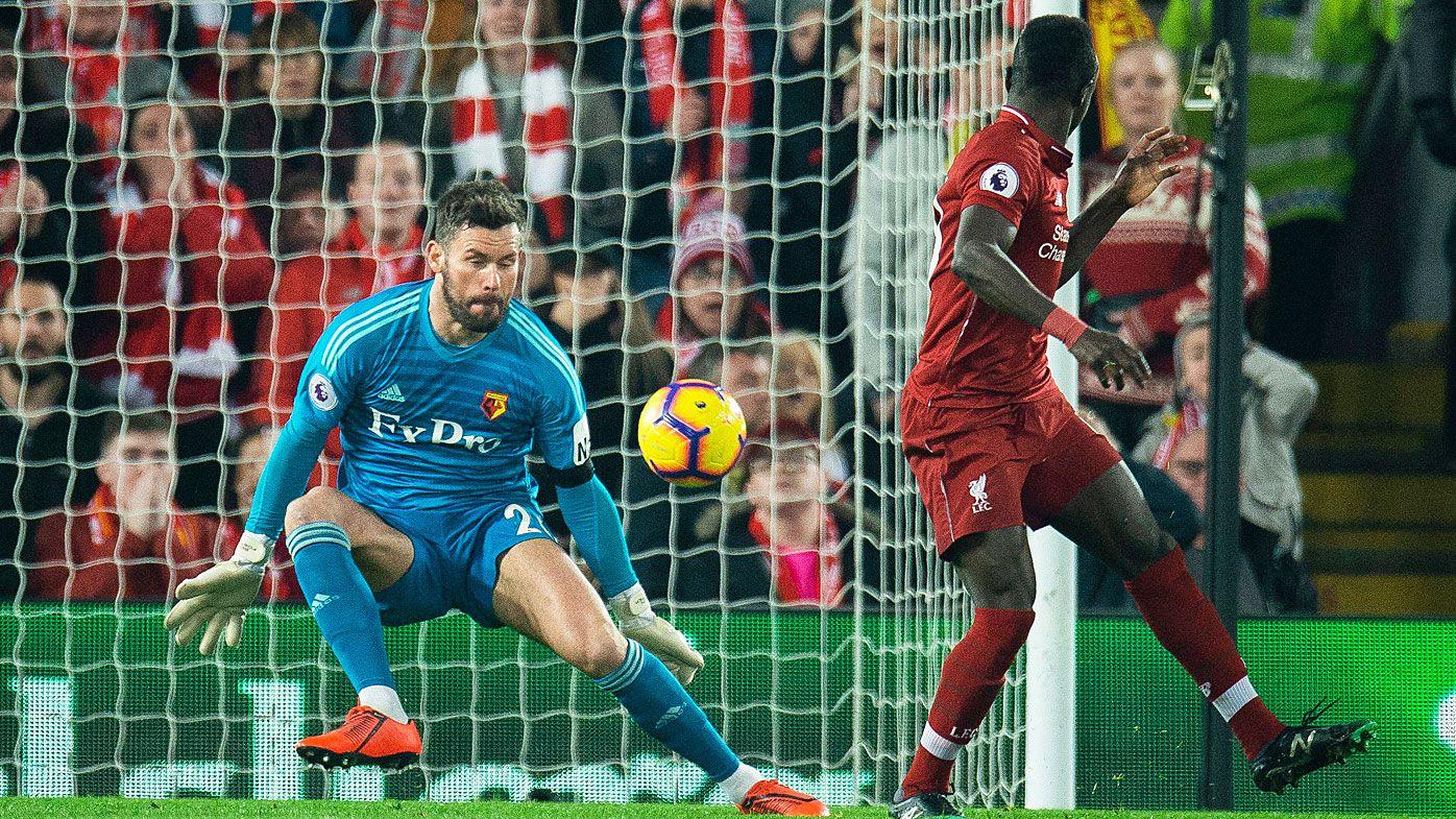 Liverpool's Sadio Mane (R) scores