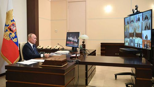 Vladimir Putin holds a video conference ahead of a national address.
