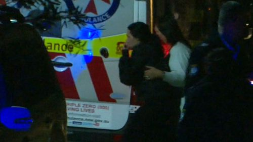A visibly distressed woman, believed to be the child's mother, at the home last night. (9NEWS)