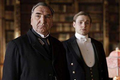 Jim Carter (butler Mr Carson) and Thomas Howes (footman William Mason).