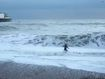 Woman runs into crashing waves to rescue dog