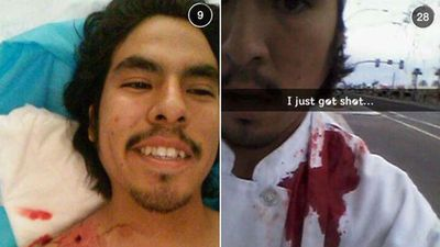 "Student Isaac Martinez was shot in the shoulder during a shooting rampage at Mesa, Arizona and posed for a bloody selfie moments after the attack that killed one and injured five. ""I had a bullet hit me from behind and go through my shoulder and out my coller [sic] area. Any higher or lower it coulda hit a artery, or shatter my shoulder blade. It was a miracle hit."""