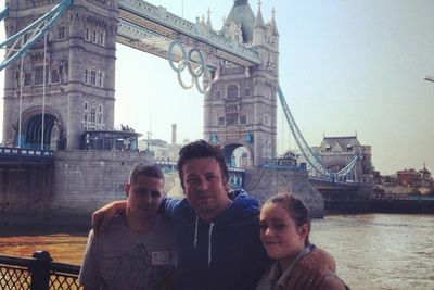 Chef Jamie Oliver at the Tower Bridge, Olympic rings and all.