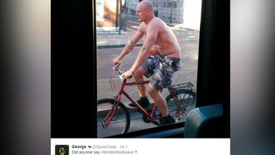 A Twitter user posted this image of a man beginning to look sunburnt, riding his bike on the streets without a shirt to cool down. (Twitter)