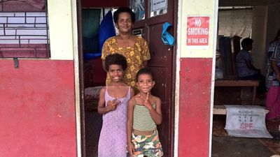 Resident Seini Cawai with her family at an evacuation centre in Ba, Fiji, after their home was lost. (AAP Image/Naziah Ali, Mai Life Magazine)