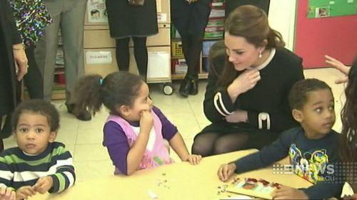 Catherine, Duchess of Cambridge, talks to children in Harlem. (9NEWS)