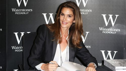 """Crawford signing her new book """"Becoming Cindy Crawford."""" (AAP)"""